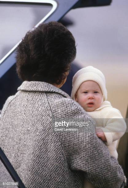 Prince Harry is carried by his nanny Barbara Barnes on March 25 1985 onto the Royal flight leaving Aberdeen airport in Scotland