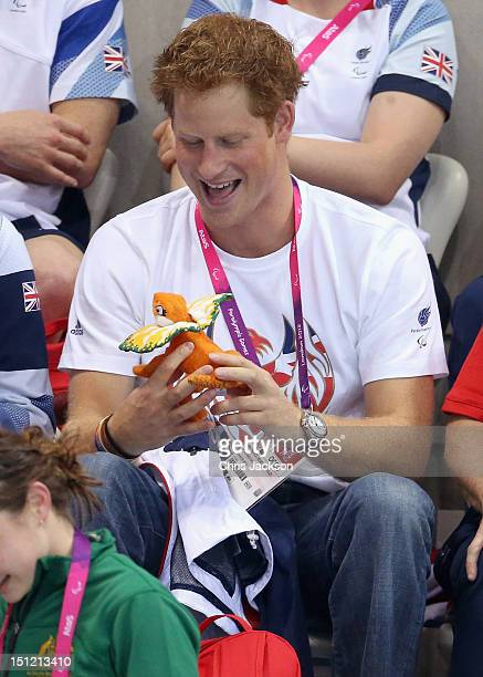 Prince Harry is given a mascot by an Australian Paralympic athlete on day 6 of the London 2012 Paralympic Games at the Aquatics Centre on September 4...