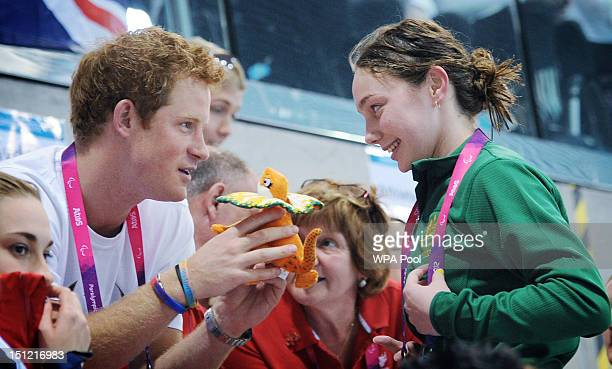 Prince Harry is given a mascot from Australian Paralympic swimmer Maddison Elliott on day 6 of the London 2012 Paralympic Games at the Aquatics...