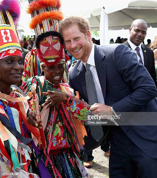 Prince Harry is greeted by cultural dancers at Brimstone Fortress during a youth rally on the fourth day of an official visit on November 23 2016 in...