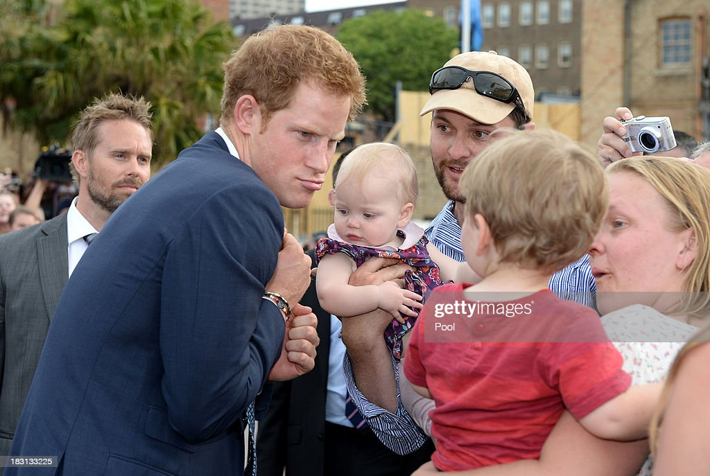 Prince Harry is greeted by members of the public at Campbell's Cove during the 2013 International Fleet Review on October 5, 2013 in Sydney, Australia. Over 50 ships participate in the International Fleet Review at Sydney Harbour to commemorate the 100 year anniversary of the Royal Australian Navy's fleet arriving into Sydney. Prince Harry is an official guest of the Australian Government and will take part in the fleet review during his two-day visit to Australia.
