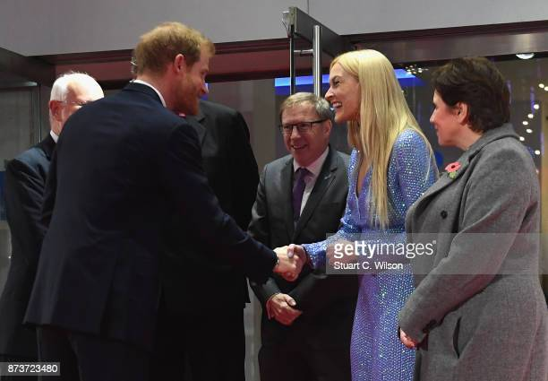 Prince Harry is greeted by Mind ambassador Fearne Cotton as he attends the Virgin Money Giving Mind Media Awards at Odeon Leicester Square on...