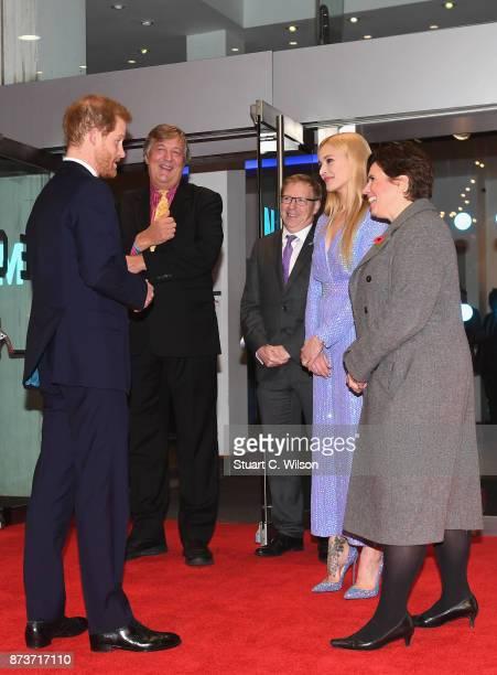 Prince Harry is greeted by President of Mind Stephen Fry and Mind ambassador Fearne Cotton as he attends the Virgin Money Giving Mind Media Awards at...