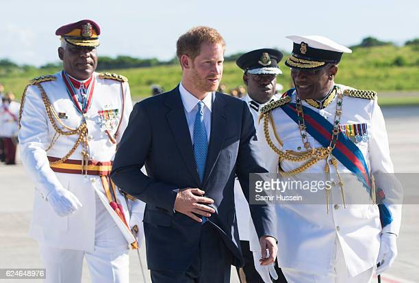 Prince Harry is greeted by the Governor General His Excellency Sir Rodney Williams as he arrives at VC Bird International Aiport on the first day of...