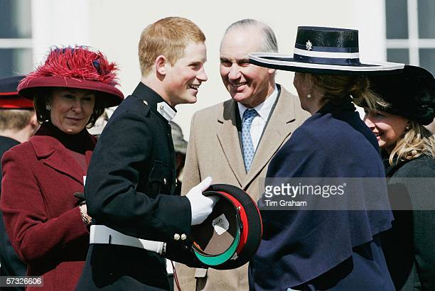 Prince Harry is greeted by Tiggy LeggeBourke and other friends at the Sovereign's Parade at Sandhurst Military Academy where he passedout as...