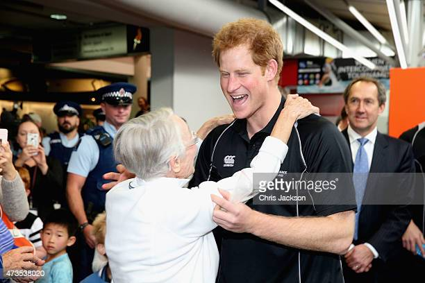 Prince Harry is hugged as he leaves the AUT Millenium Institute on May 16 2015 in Auckland New Zealand Prince Harry is in New Zealand from May 9...