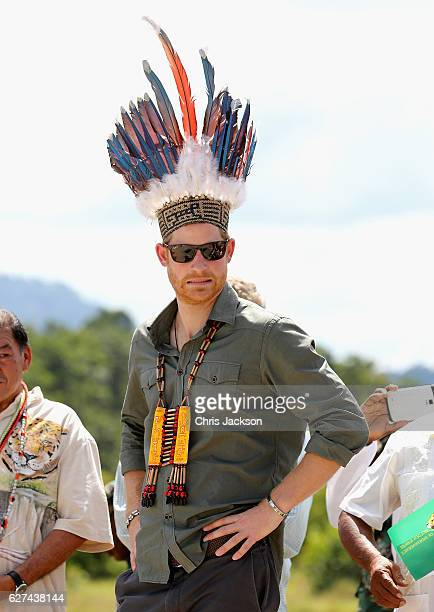 Prince Harry is presened with a headdress by dancers in Surama Village in the Guyana Hinterland on day 13 of an official visit to the Caribbean on...