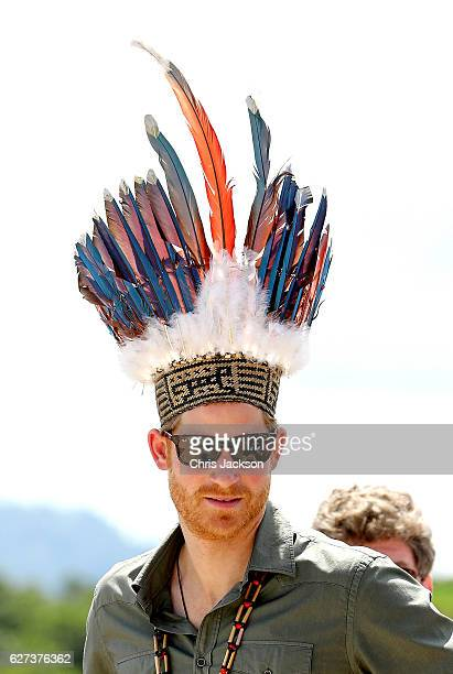 Prince Harry is presented with a headdress by dancers in Surama Village in the Guyana Hinterland on day 13 of an official visit to the Caribbean on...