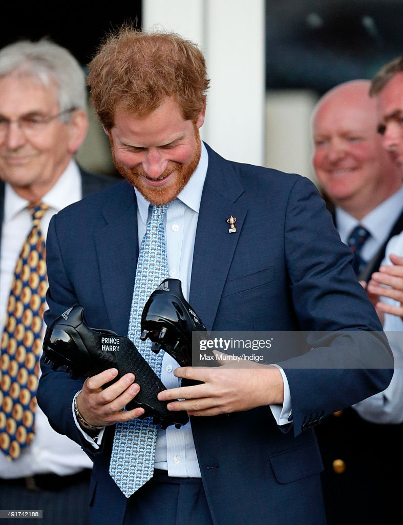 Prince Harry is presented with a pair of rugby boots with his name stitched into them as he visits Paignton Rugby Club to present them with an RFU, Gold Standard Facilities Award on October 7, 2015 in Paignton, England.