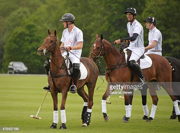 Prince Harry John Paul Clarkin Prince William Duke of Cambridge play during day two of the Audi Polo Challenge at Coworth Park on May 31 2015 in...