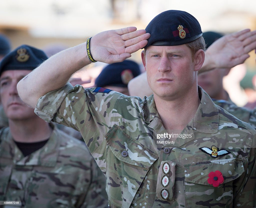 Prince Harry joins British troops and service personal remaining in Afghanistan and also International Security Assistance Force (ISAF) personnel and civilians as they gather for a Remembrance Sunday service at Kandahar Airfield November 9, 2014 in Kandahar, Afghanistan. As the the UK combat mission in Afghanistan draws to an end in 2014 this year, which also marks the 100th anniversary of the start of World War One, 70 years since the D-Day landings will be the last time British service personal will gather in any great numbers in the south of the country.