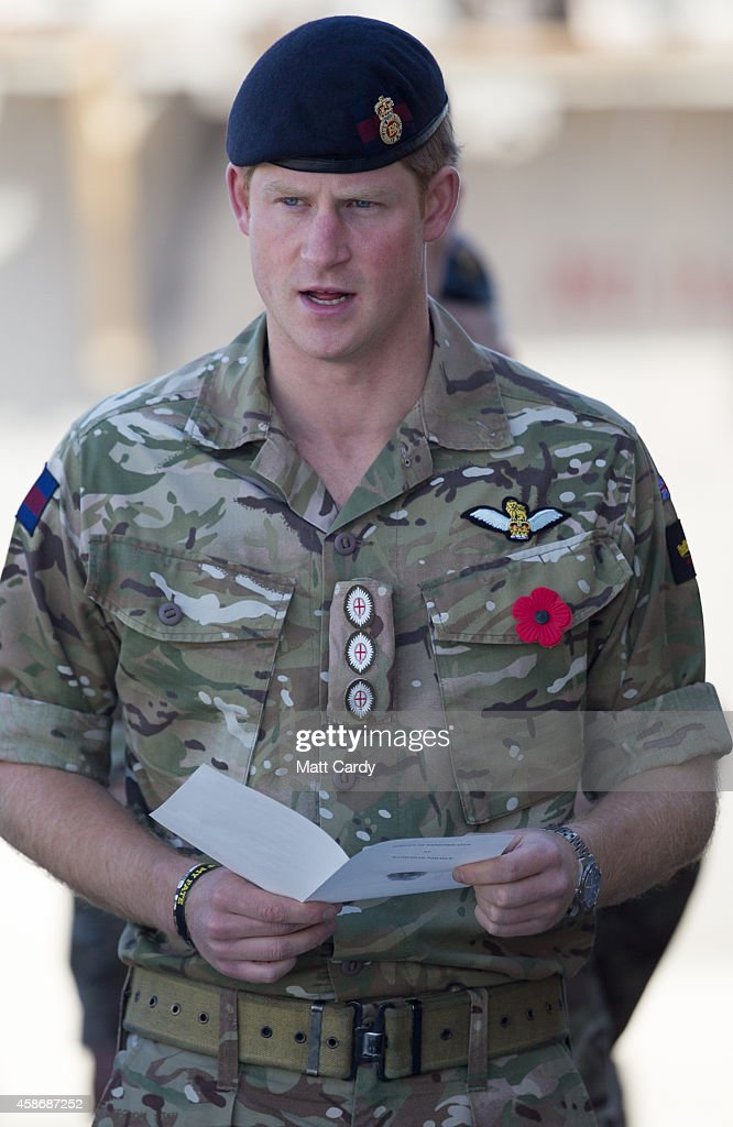 Prince Harry (C) joins British troops and service personal remaining in Afghanistan and also International Security Assistance Force (ISAF) personnel and civilians as they gather for a Remembrance Sunday service at Kandahar Airfield November 9, 2014 in Kandahar, Afghanistan. As the UK combat mission in Afghanistan draws to an end in 2014 this year, which also marks the 100th anniversary of the start of World War One, 70 years since the D-Day landings will be the last time British service personal will gather in any great numbers in the south of the country.