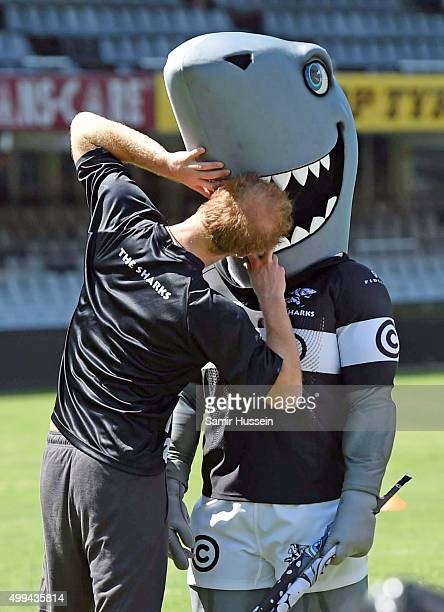 Prince Harry jokes around the mascot of The Sharks rugby club at Kings Park Stadium during an official visit to Africa on December 1 2015 in Durban...