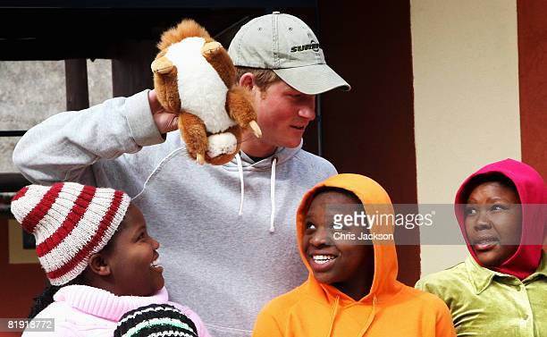 Prince Harry jokes around with children during a visit to LCCU on July 9, 2008 in Maseru, Lesotho. Prince Harry and 26 soldiers from the Household...