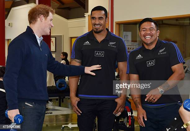 Prince Harry jokes with All Black Jerome Kaino and Keven Mealamu as he visits Auckland Spinal Rehabiltation Unit on May 15 2015 in Auckland New...