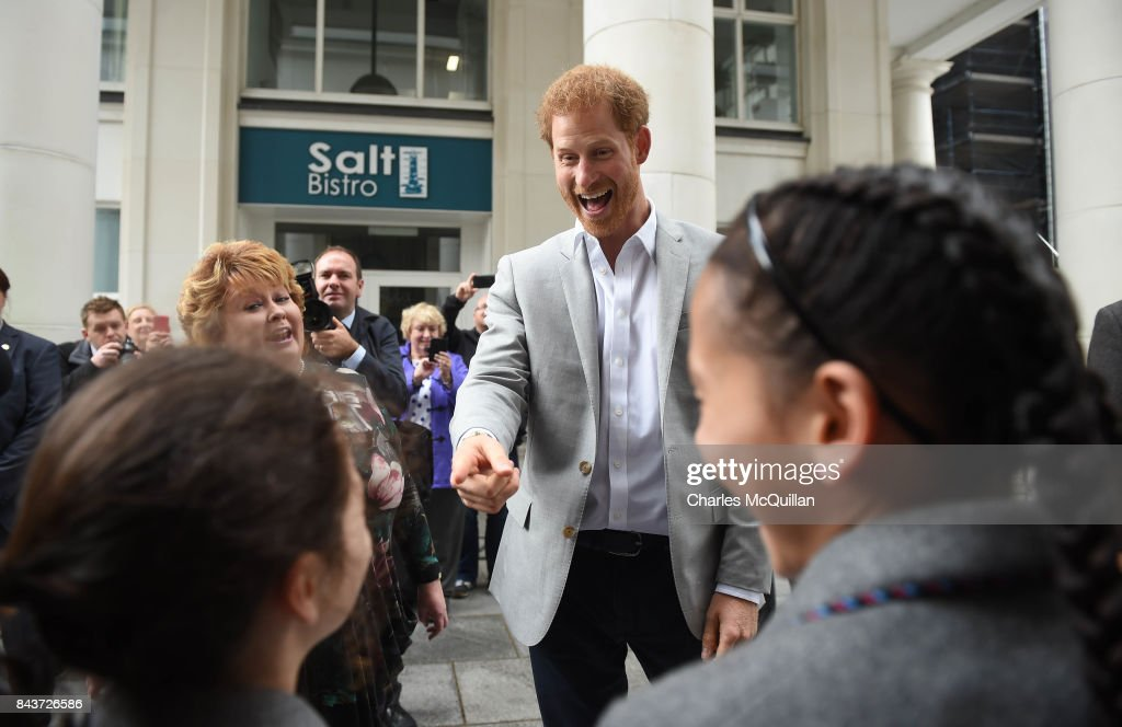 Prince Harry jokes with school children that they should be at school as he meets members of the public as he toured St. Anne's Square as part of his visit to the Mac on September 7, 2017 in Belfast, Northern Ireland. The one day visit to the province is the Prince's first visit to Northern Ireland.