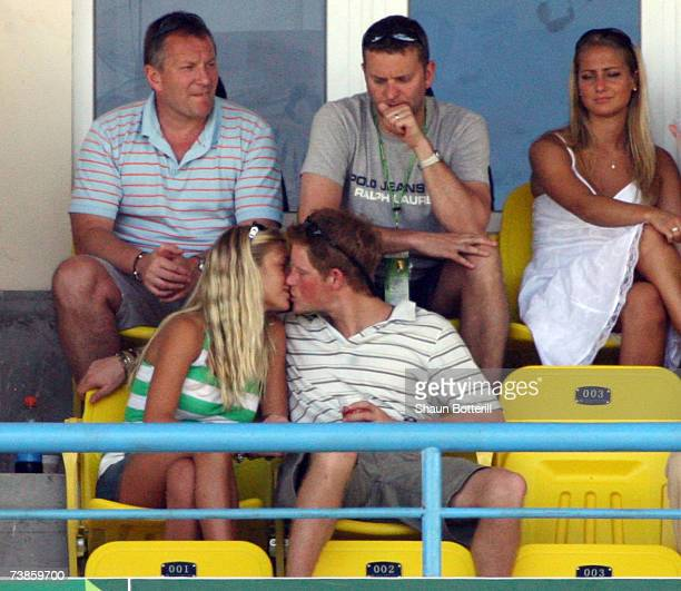 IL 08 Prince Harry kisses girlfriend Chelsy Davy as they watch the action during the ICC Cricket World Cup 2007 Super Eight match between England and...
