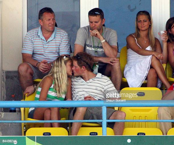 ST JOHN'S ANTIGUA AND BARBUDA APRIL 08 Prince Harry kisses girlfriend Chelsy Davy as they watch the action during the ICC Cricket World Cup 2007...