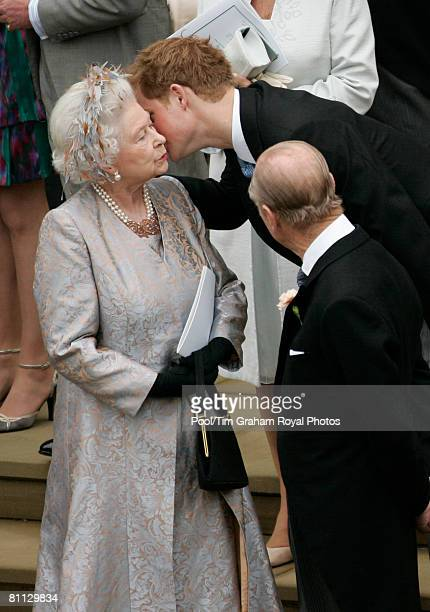 Prince Harry kisses his grandmother Queen Elizabeth II after the wedding of Peter Phillips to Autumn Kelly at St George's Chapel in Windsor Castle on...