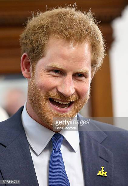 Prince Harry laughs as he attends a reception for supporters and organisers of the Invictus Games Toronto at the Office of the Lieutenant Governor on...
