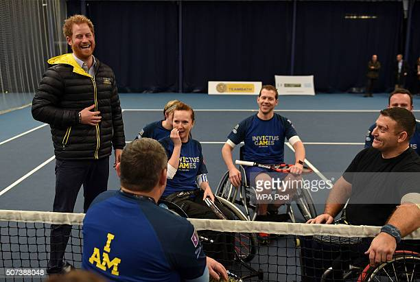 Prince Harry laughs as he chats to competitors in the wheelchair tennis as he attends the Invictus Games Orlando British team trials at the...