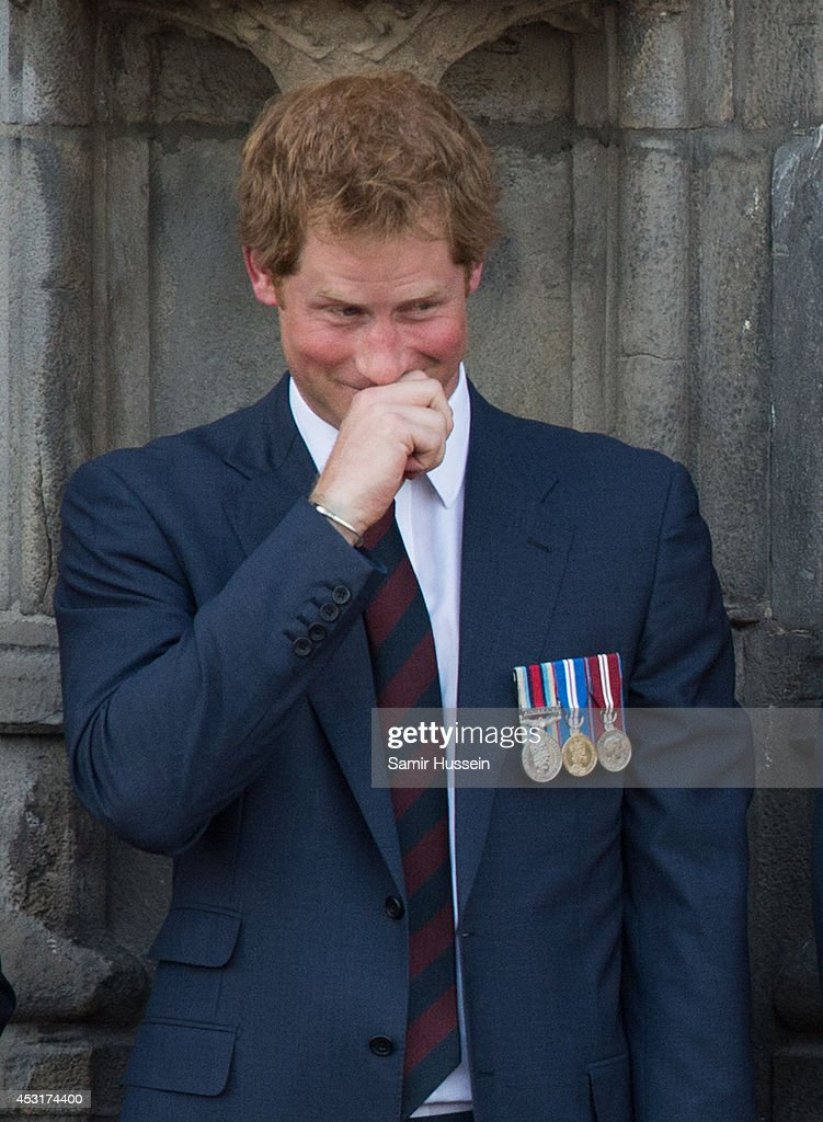 Prince Harry laughs from the balcony of the town hall as they attend a reception at the Grand Place on August 4, 2014 in Mons, Belgium. Monday 4th August marks the 100th Anniversary of Great Britain declaring war on Germany. In 1914 British Prime Minister Herbert Asquith announced at 11pm that Britain was to enter the war after Germany had violated Belgium's neutrality. The First World War or the Great War lasted until 11 November 1918 and is recognised as one of the deadliest historical conflicts with millions of casualties. A series of events commemorating the 100th Anniversary are taking place throughout the day.