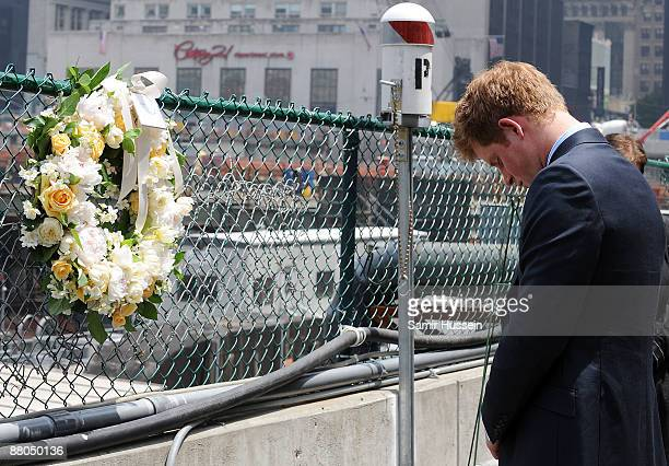 Prince Harry lays a wreath as he pays his respects at the World Trade Centre site on May 29, 2009 in New York. Prince Harry is on a two day visit to...