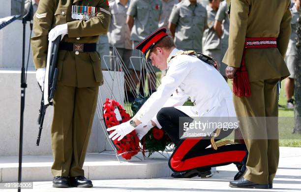 Prince Harry lays a wreath during the New Zealand commemoration at the Cassino Commonwealth War Cemetery on May 18 2014 in Monte Cassino Italy Prince...