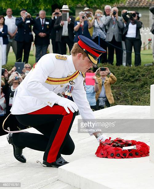 Prince Harry lays a wreath during the UK commemoration at the Cassino Commonwealth War Cemetery on May 19 2014 in Cassino Italy Prince Harry will...