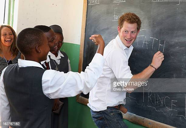 Prince Harry learns sign language as he visits Kananelo Centre for the deaf a project supported by his charity Sentebale on February 27 2013 in...