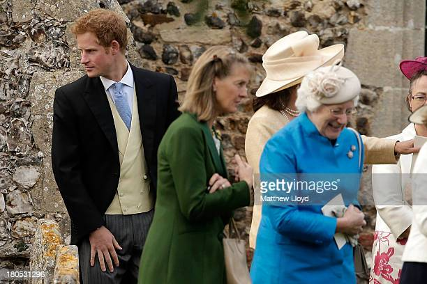 Prince Harry leaves after the wedding of James Meade and Lady Laura Marsham at St Nicholas' Church in Gayton on September 14 2013 in King's Lynn...