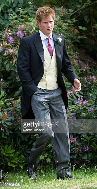 Prince Harry leaves the wedding of former Royal Equerry Mark Dyer and Amanda Kline at St Edmunds Church on July 3 2010 in Abergavenny Wales