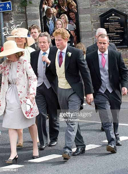 Prince Harry leaves the wedding of former Royal Equerry Mark Dyer and Amanda Kline at St Edmund's Church on July 3 2010 in Abergavenny Wales