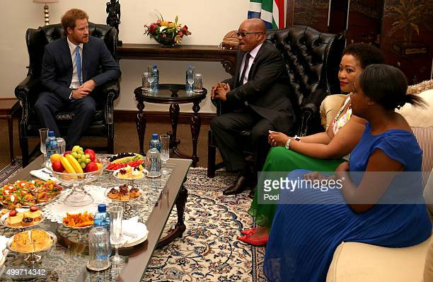 Prince Harry listens during a meeting with South African President Jacob Zuma also attended by his wife and daughter Tobeka Madiba Zuma and Msholozi...