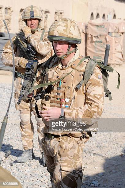 Prince Harry listens to a briefing before going on patrol through the deserted town of Garmisir on January 2 2008 in Helmand Province Afghanistan