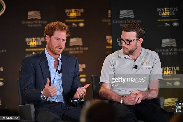 Prince Harry listens to LCpl John-James Chalmers is seen during the Opening Ceremony of the Invictus Games Orlando 2016 at ESPN Wide World of Sports...