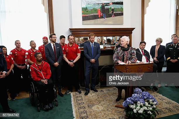 Prince Harry listens to the Honourable Elizabeth Dowdeswell Lieutenant Governor at a reception for supporters and organisers of the Invictus Games...