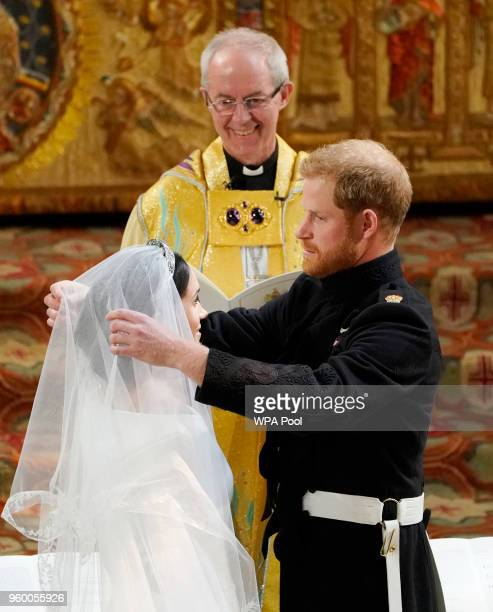 Prince Harry looks at his bride Meghan Markle during their wedding service conducted by the Archbishop of Canterbury Justin Welby in St George's...