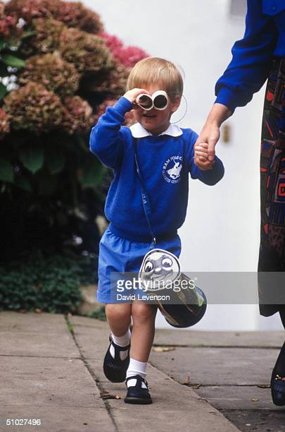Prince Harry looks at photographers as he leaves on his first day at Mrs. Mynor's nursery school on September 16, 1987 in Notting Hill, London.