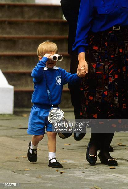 Prince Harry looks at photographers with a pair of binoculars as he leaves on his first day at Mrs Mynor's nursery school on September 16 1987 in...