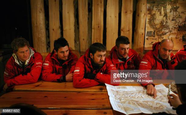 Prince Harry looks at some maps with Jaco Van Gass Martin Hewitt Steven Young and Simon Dalglish as he joins the Walking with the Wounded team who...