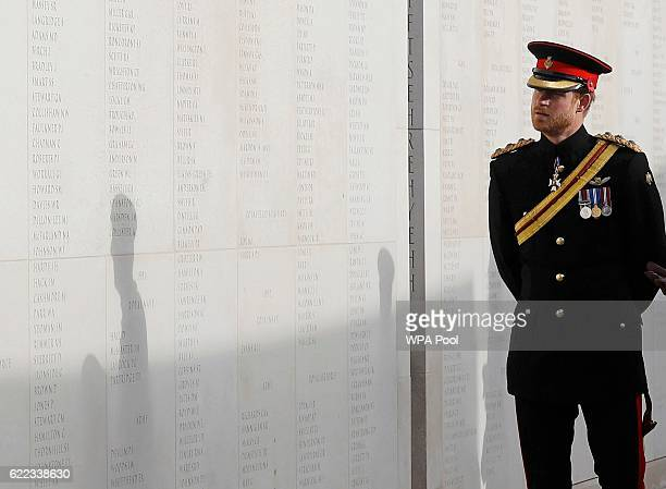 Prince Harry looks at the Armed Forces Memorial as he attends The Armistice Day commemorations at The National Memorial Arboretum on November 11 2016...