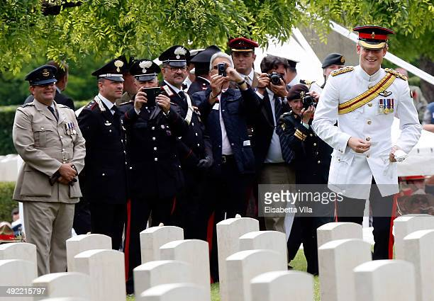 Prince Harry looks at the graves at the end of the UK commemoration at the Cassino Commonwealth War Cemetery on May 19 2014 in Cassino Italy Prince...