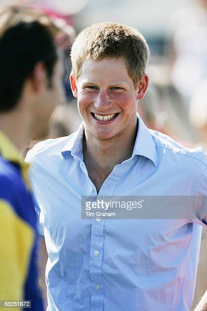 Prince Harry looks on at Cirencester Park before taking part in a polo match for the Emlor team against the Corramore team at Cirencester on July 17...