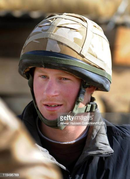 Prince Harry looks thoughtful as he sits at the observation posst on JTAC Hill on January 2, 2008 in Helmand Province, Afghanistan.