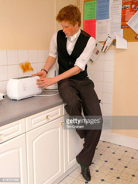 Prince Harry makes a slice of toast in his house kitchen located in the House Library of Eton School