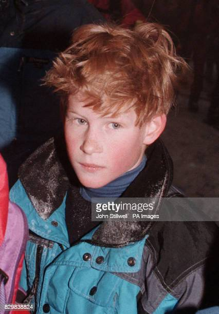 Prince Harry makes his way past a large group of photographers and sightseers, as the Royal party walk to a waiting car. The young Prince had been...