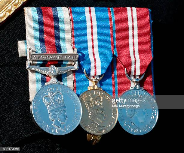 Prince Harry medals detail attends the Armistice Day Service at the National Memorial Arboretum on November 11 2016 in Alrewas England Armistice Day...