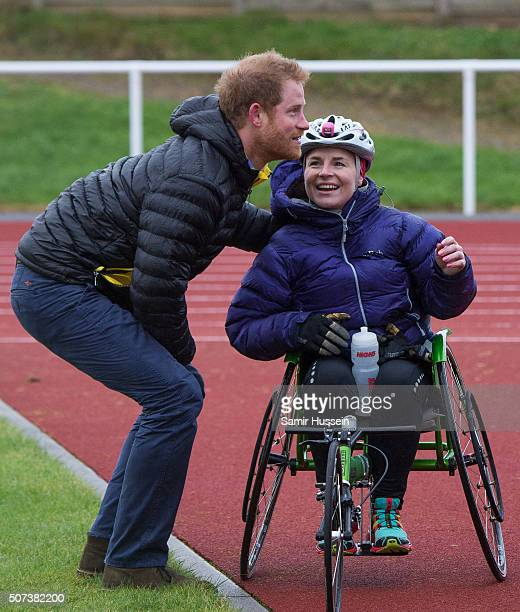 Prince Harry meets a competitor as he attends the UK team trials for the Invictus Games Orlando 2016 at University of Bath on January 29 2016 in Bath...