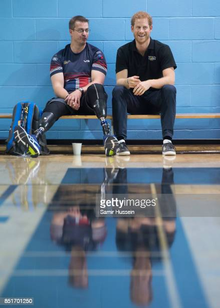 Prince Harry meets a competitor as he visits Invictus Games sports training at Toronto Pan Am Sports Centreon day 1 of the Invictus Games Toronto...